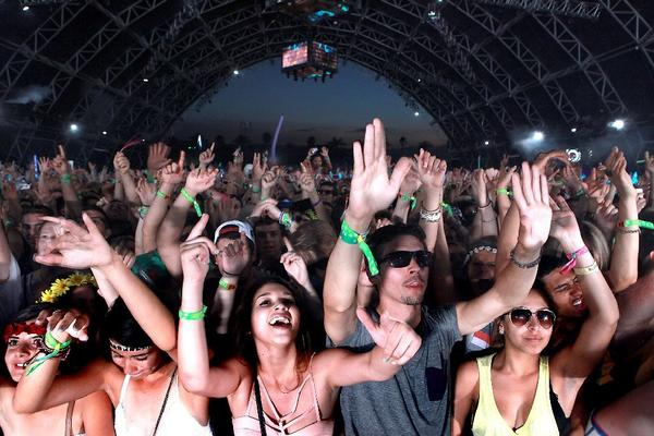 Fans in the Sahara tent dance to Dog Blood at the Coachella Music & Arts Festival Friday night.