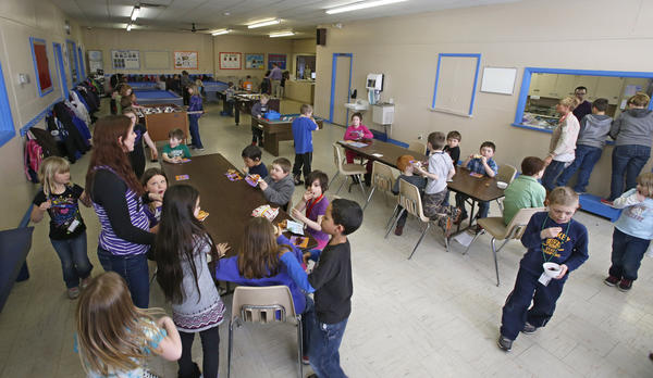 A group of Boys and Girls Club of Aberdeen Area members enjoy snack time Friday afternoon. The Boys and Girls Club is in the midst of a fundraising campaign to build a new facility. One of the reasons the club is seeking a new facility is to make room for its growing membership.
