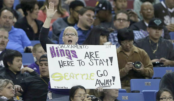 A Sacramento Kings fan show her support to keep the team in Sacramento during an NBA basketball game against the Houston Rockets on April 3, 2013.