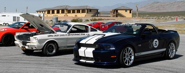 A 2012 Ford Mustang Boss 302, a 1965 Shelby GT350, and a 2013 Shelby GT350 convertible await their turn on the track during the 6th annual Shelby Bash at Spring Mountain Motorsports Ranch in Pahrump, Nev. Shelby American is transitioning to new vehicles, hot-rod parts and revenue sources beyond just the modified pony cars for which is it known.