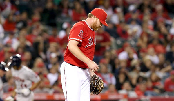 Pitcher Tommy Hanson reacts as Justin Maxwell circles the bases after hitting a solo home run in the second inning of the Angels' 5-0 loss to the Houston Astros.