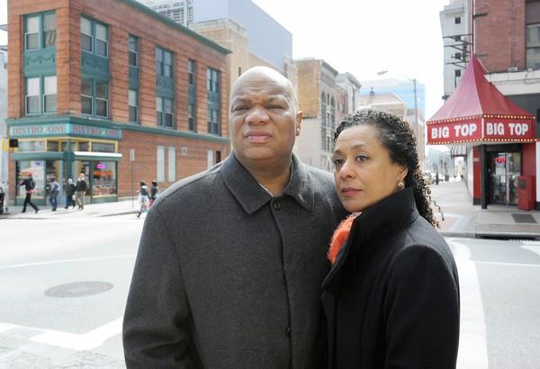Hopkins professor Michael Hanchard and his wife, Zita Nunes pictured at the intersection at Baltimore and Gay St. where their car was surrounded by youths on bicycles.