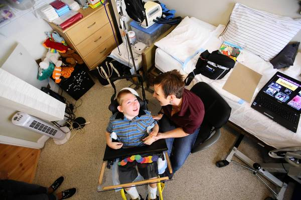 Ten-year-old Ethan Rediske, who has cerebral palsy and is mostly blind, smiles, listening to his mother, Andrea Rediske, at their Avalon Park home, Friday, April 12, 2013. Orange County Public Schools administrators have required Ethan to take the state FCAT test, despite his severe brain damage. Andrea Rediske has been fighting the policy for three years.