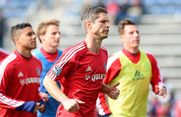 Fire midfielder Logan Pause runs of the field after the first half against the Red Bulls at Toyota Park.