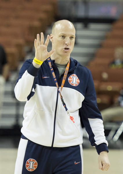 Illini coach John Groce leads his team through practice in preparation for an NCAA tournament game.