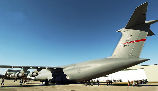 In this file photo, people are dwarfed by the size of the C-5 on display at 167th Air National Guard in Martinsburg, W.Va.