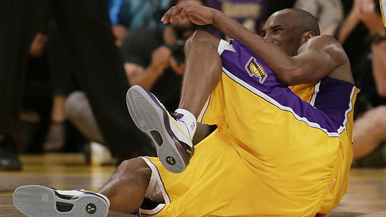Lakers guard Kobe Bryant writhes in pain after he injured his left Achilles' tendon with 3:08 left to play in the fourth quarter against the Golden State Warriors on Friday night at Staples Center.