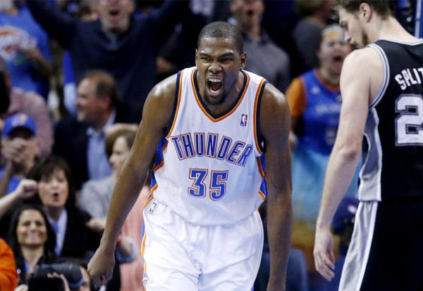 Oklahoma City Thunder forward Kevin Durant (35) celebrates after a dunk against the San Antonio Spurs.