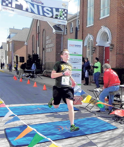 Tyler Shelly, 19, of Mercersburg, Pa., hits the finish line Saturday at the Flannery's Pub Run Half Marathon. Shelly finished with a time of 1:40:50.