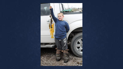 Isaac Falcon, 6, of Canonsburg proudly shows off his stringer full of trout including large golden rainbow Saturday.