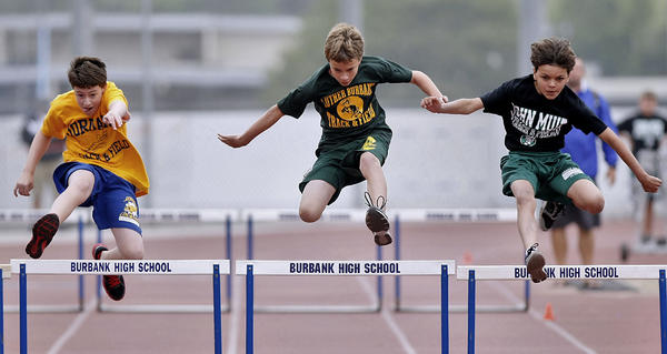 Students from Jordan, Luther Burbank and John Muir Middle Schools participated in the annual All-City Track and Field Meet at Burbank High School in Burbank on Saturday, April 13, 2013. At center is Ethan Galloway, 12 and in 6th grade, from LBMS.