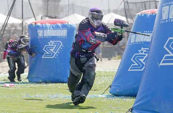 Two members of the professional team Buffalo Crush compete during the 11th annual Surf City USA Open, hosted by the National Professional Paintball League at Huntington Beach Pier on Friday.
