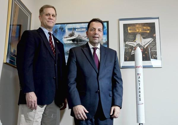 Dale K. Nash, left, executive director of the Virginia Commercial Space Flight Authority, and Oktay Baysal, dean of the Frank Batten College of Engineering & Technology at Old Dominion University, stand with a model of the Antares rocket.