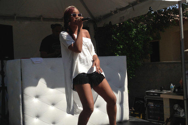 Eve performs at the Nylon party at Lake La Quinta Inn resort Saturday afternoon.