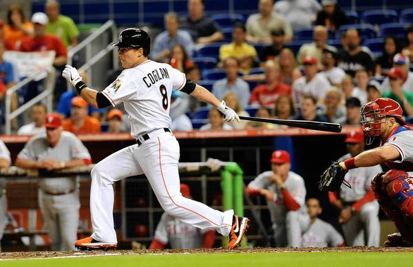 Miami Marlins center fielder Chris Coghlan (8) connects for the game-winning RBI single in the ninth inning against the Philadelphia Phillies at Marlins Park on Saturday night.