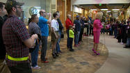 "Anchorage men strapped on stilettos to raise money Saturday afternoon for ""Standing Together Against Rape,"" a women's advocacy project, at a midtown mall."