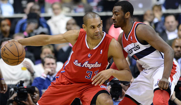 Grant Hill, shown against New York's Raymond Felton in February, scored five points on two-for-three shooting, had one rebound and two blocked shots during the Clippers 91-87 victory over Memphis on Saturday.