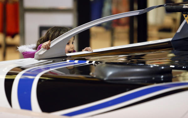 A wide-eyed Elizabeth Thelen, 4, of Marcus, Iowa, checks out one of the many cars on display Saturday at the Brown County Speedway Car Show at Lakewood Mall. Thelen was in Aberdeen with her family visiting relatives. Over 30 cars and go karts will still be on display at the mall today.