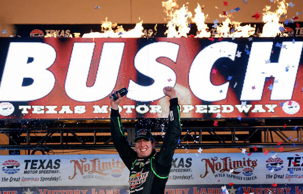 Kyle Busch celebrates in Victory Lane after winning the NASCAR Sprint Cup Series NRA 500 at Texas Motor Speedway.
