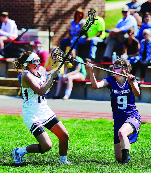 Saint James' Madison Fahey, left, and Smithsburg's Mattie Hoover battle for a loose ball on Saturday during the Saints' 18-14 victory.