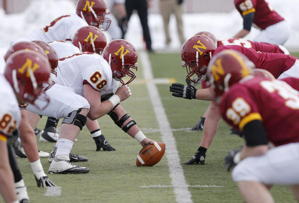 Northern State University's Hayden Gowan, left, sets up over the ball as he lines up against Nick Murphy, right, during Saturday's Spring Game at Swisher Field. photo by john davis taken 4/13/2013