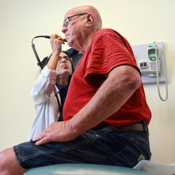 Physician Mona Sinno checks out patient Joseph Meyer at the Bernard P. Alicki Health Center, operated by Broward Health, in Fort Lauderdale on Tuesday. Although doctors have been seeing hiomeless patients in the new clinic for more than a month, the official opening happens Thursday.