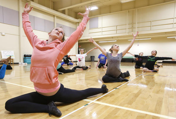 Paige Wellman, left and Paige Voegele, center, stretch along with their classmates in the Jazz IV class as they warm up during class Tuesday at the Aberdeen Recreation and Cultural Center. photo by john davis taken 4/9/2013