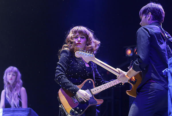 The Postal Service performs, with Jenny Lewis, center, and Ben Gibbard, right.