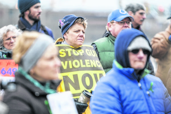 Local residents partake in a rally Saturday in front of South Bend's Morris Performing Arts Center to urge U.S. senators to pass an expansion of gun control laws.