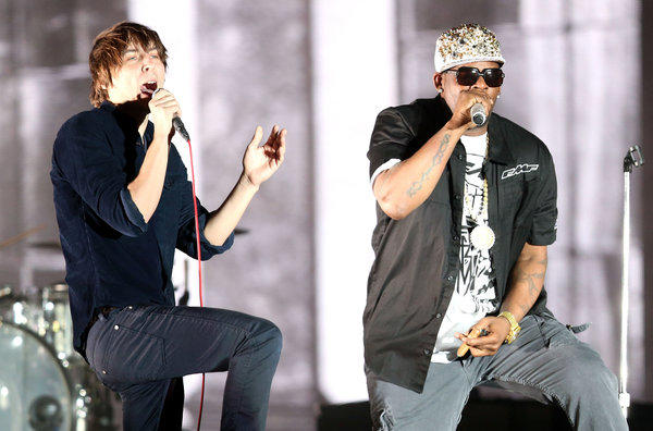 Thomas Mars of the band Phoenix, left, and R. Kelly perform at Coachella.