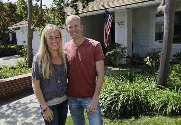 Mollie and Jim Rosing, who both attended Corona del Mar High and live in Newport Beach, will run in the Boston Marathon on Monday.