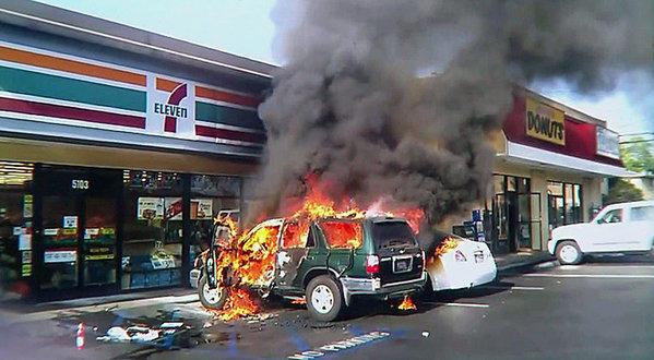 Fire outside 7-Eleven in Long Beach Friday.