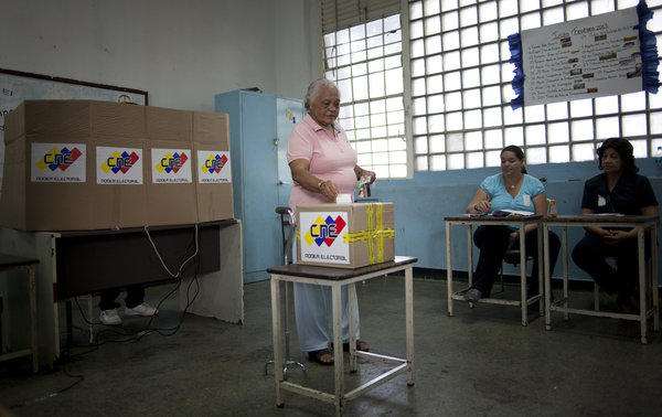 A woman casts her ballot in the presidential election in Caracas, Venezuela.