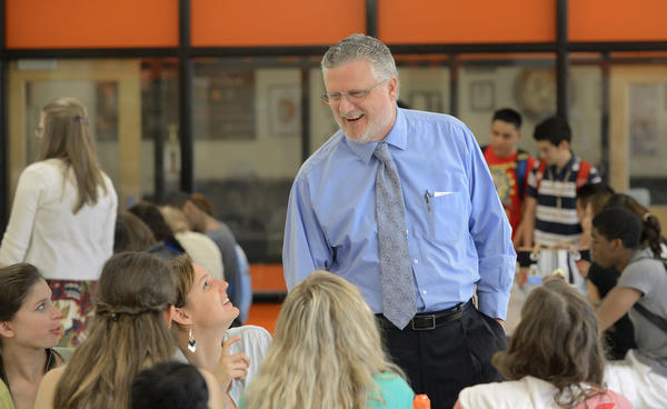 Oakland Mills High School principal Frank Eastham has overcome many obstacles to become one of the most admired administrators in the county. He recently won the state Association of Student Councils Principal of the Year award. Here, he interacts with students in the school cafeteria.