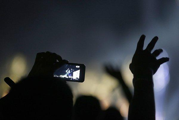 A fan reaches out during a performance by the Postal Service at the Coachella Valley Music and Arts Festival in Indio.