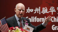 GUANGZHOU, China -- Gov. Jerry Brown said Sunday that his administration will come up with a plan for reducing the state prison population by an additional 10,000 inmates, even as it asks the U.S. Supreme Court to block a judicial order demanding such a recommendation.