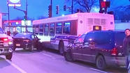 Eight people were injured early Sunday morning when two cars hit a CTA bus on the West Side, officials say.