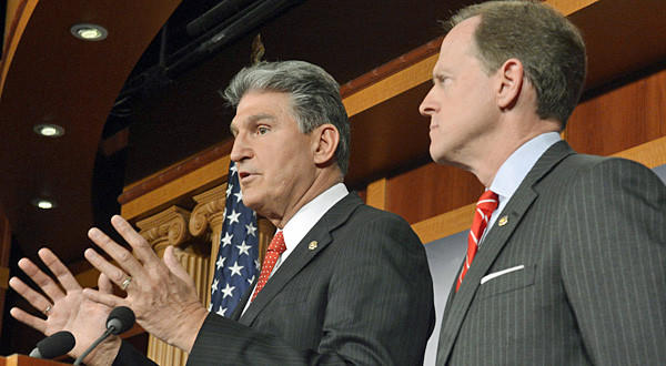 Democratic Senator from West Virginia Joe Manchin, left, and Republican Senator from Pennsylvania Pat Toomey, right, introduce gun control legislation that has bipartisan support.