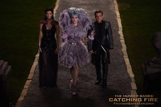 Katniss Everdeen (Jennifer Lawrence), Effie Trinket (Elizabeth Banks) and Peeta Mellark (Josh Hutcherson)