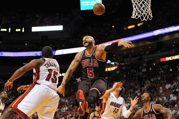 Carlos Boozer is fouled by the Heat's Mario Chalmers during the first