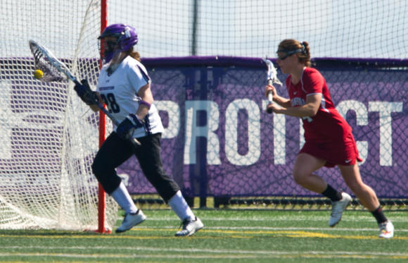 Bridget Bianco clears after one of her nine saves.