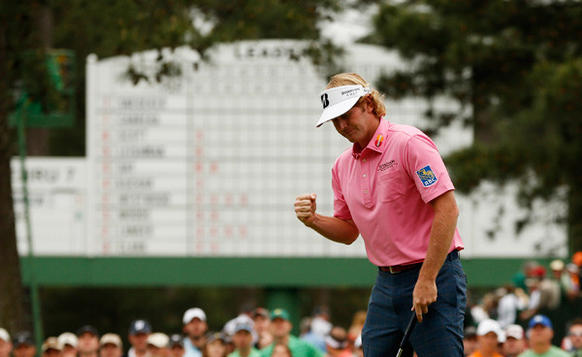 Brandt Snedeker reacts to sinking a birdie putt during the final round play in the 2013 Masters at the Augusta National Golf Club.