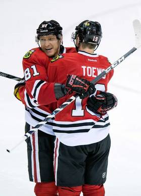 Blackhawks winger Marian Hossa (81) celebrates with center Jonathan Toews after scoring during the third period.