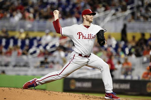 Roy Halladay recorded his 200th career win Sunday as the Phillies beat the Marlins 2-1.