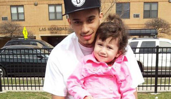 Miguel Cancel, 19, with his daughter Katie, 2, in an undated photograph. Cancel was fatally shot early Saturday.