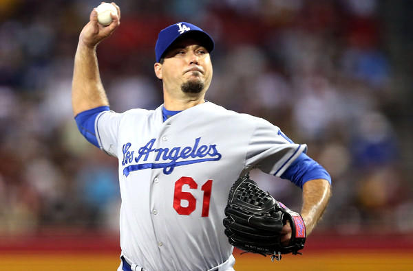Dodgers starting pitcher Josh Beckett delivers a pitch against Diamondbacks on Sunday afternoon in Phoenix.