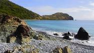 CRUZ BAY, St. John (Reuters) - The tiny island of St. John is the smallest, most pristine of the U.S. Virgin Islands, with two-thirds of its land mass given over to national parkland thanks to a 1956 donation from philanthropist-conservationist Laurance Rockefeller.