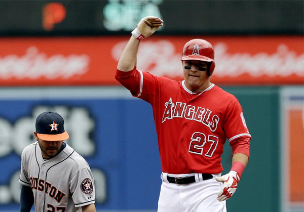 The Angels' Mike Trout celebrates after heading into second base with a double in the first inning.