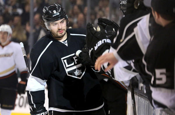 Kings defenseman Drew Doughty is congratulated as he arrives at the bench after scoring a goal against the Ducks in the first period Saturday night.