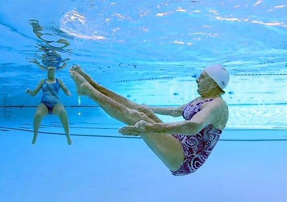 Two women practice synchronized swimming in Sun City, Arizona